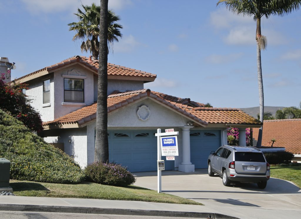 "A home with an ""In Escrow"" sign in Encinitas, Calif. (AP Photo/Lenny Ignelzi)"