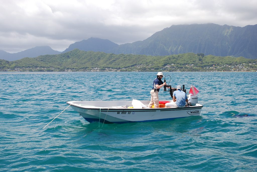 In this Tuesday, June 7, 2016 photo, CORAL (Coral Reef Airborne Laboratory) team members Brandon Russell, a postdoctoral student at the University of Connecticut COLORS Lab, left and Rodrigo Garcia, a postdoctoral student at the University of Massachusetts, Boston, right, prepare to deploy optical measuring instruments in Oahu's Kaneohe Bay, near Kaneohe, Hawaii. NASA's Jet Propulsion Laboratory and reef scientists from around the world are announcing the launch of a campaign Thursday, June 9 to gather new data on coral reefs like never before. Using specially designed instruments mounted on high-flying aircraft, the scientists are embarking on a mission to map large swaths of coral around the world in hopes of better understanding how environmental changes are impacting these delicate and important ecosystems. The CORAL team will study the reefs of Hawaii, Palau, the Mariana Islands, and Australia's Great Barrier Reef over the next three years. (AP Photo/Caleb Jones)