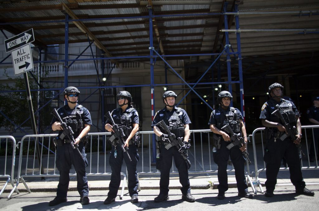 Heavily armed police officers stand guard near a news conference by Chief James R. Waters, New York Police Dept. Chief of Counterterrorism and Mayor Bill de Blasio on Sunday, June 12, 2016, in New York. Waters and Blasio were briefing reporters on NY's reaction and preparedness in response to early Sunday's Florida gay nightclub shooting. (AP Photo/Mary Altaffer)
