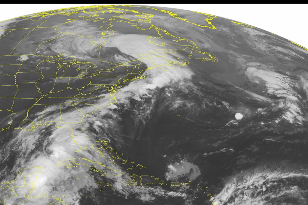 This NOAA satellite image taken Monday, June 6, 2016 at 12:45 a.m. EDT shows Tropical Storm Colin continuing to move due north over eastern portions of the Gulf of Mexico. Some of the outer rain bands have also begun moving over the western Florida shoreline as the tropical storm continues to move northward. An extended area of clouds is observed stretching from a low pressure system over southern Quebec over much of the eastern seaboard and connecting to Colin. Much of the central United States remains cloud-free with high pressure dominating. (NOAA/Weather Underground via AP)