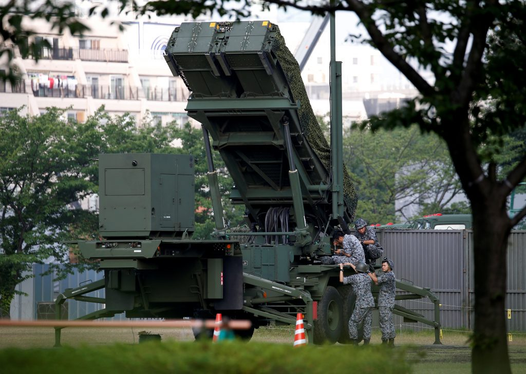 Japan Self-Defense Forces soldiers are seen next to a unit of Patriot Advanced Capability-3 (PAC-3) missiles at the Defense Ministry in Tokyo, Japan June 21, 2016. REUTERS/Issei Kato TPX IMAGES OF THE DAY