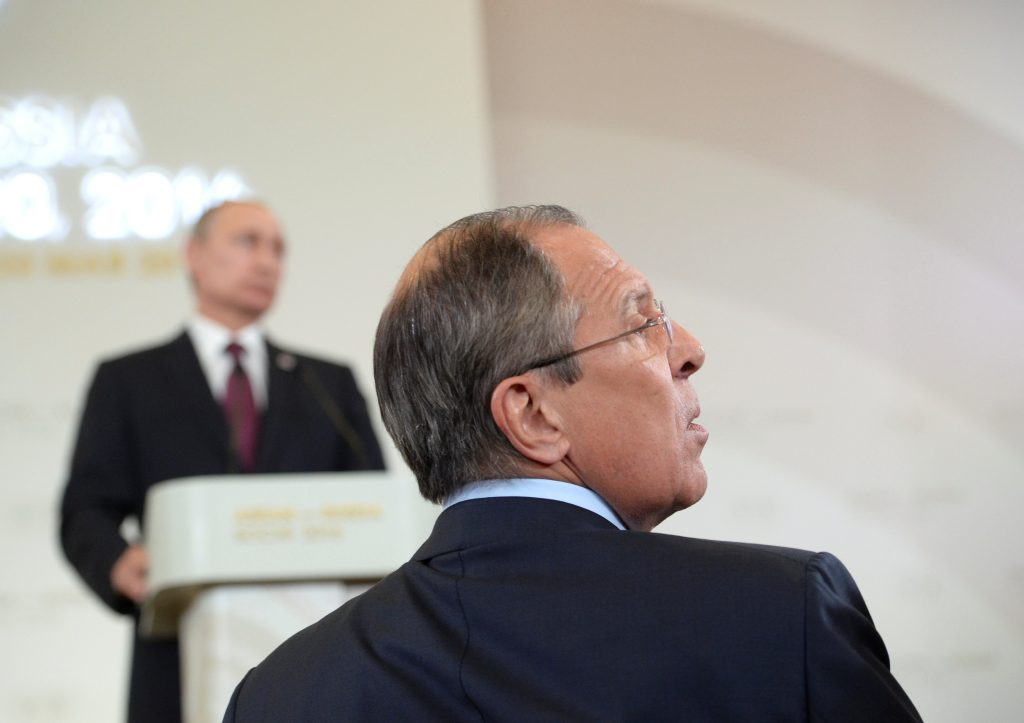 Russian Foreign Minister Sergei Lavrov seen in the foreground at a news conference of Russian President Vladimir Putin. (Host photo agency via Reuters)
