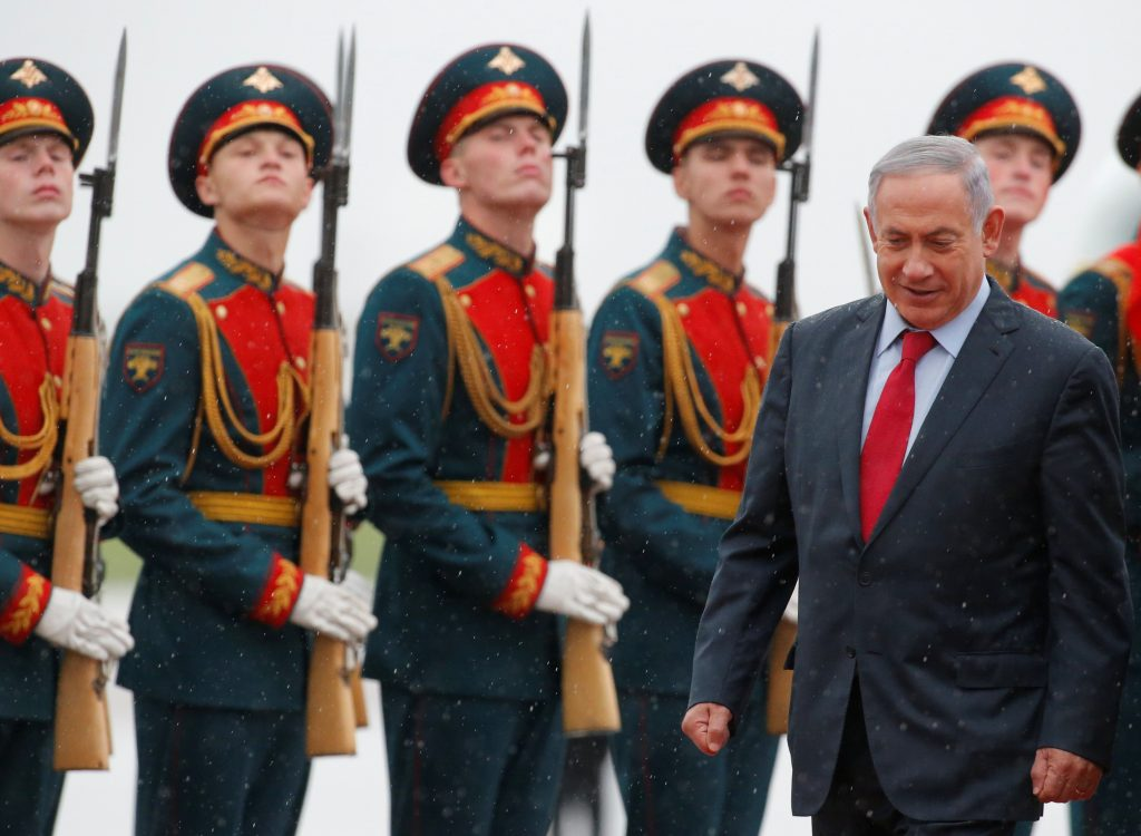 Israeli Prime Minister Binyamin Netanyahu inspects the honor guard during a welcoming ceremony upon his arrival at Moscow's Vnukovo Airport, Monday. (Reuters/Sergei Karpukhin)