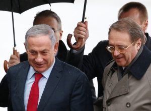 Russia's Deputy Foreign Minister Mikhail Bogdanov and Israeli Prime Minister Binyamin Netanyahu at a welcoming ceremony at Moscow's Vnukovo Airport, Monday. (Reuters/Sergei Karpukhin)