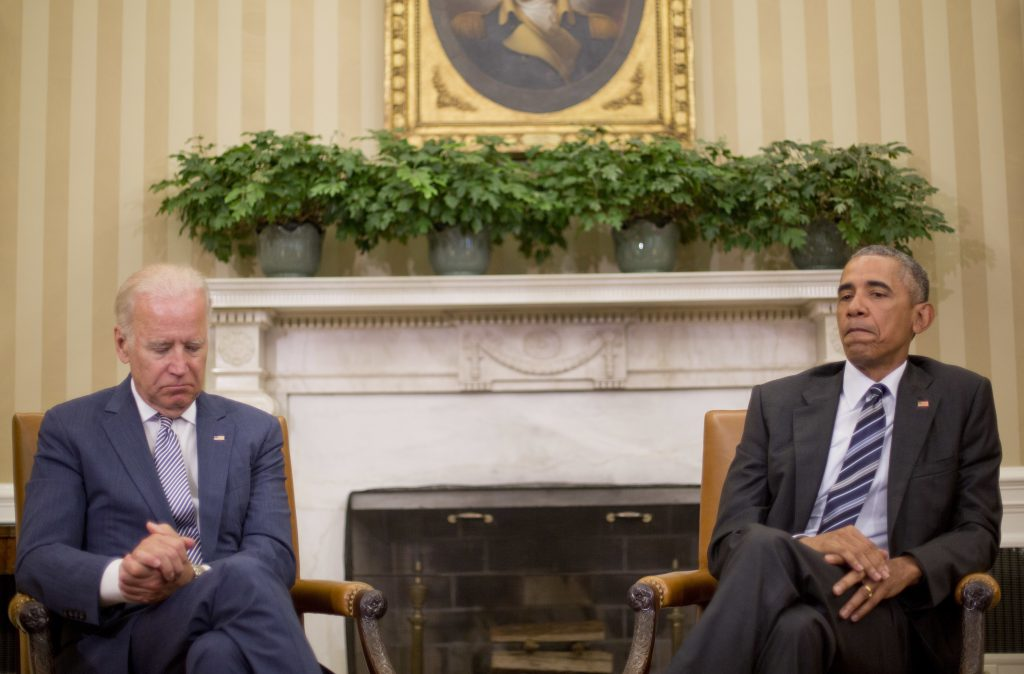 President Barack Obama, right, pauses while speaking to members of the media in the Oval Office of the White House in Washington, Monday, June 13, 2016, after getting briefed on the investigation in to the shooting at a nightclub in Orlando. With Obama is Vice President Joe Biden, left. Obama said the investigation is at the preliminary stages and is being treated as a terrorist investigation. (AP Photo/Pablo Martinez Monsivais)