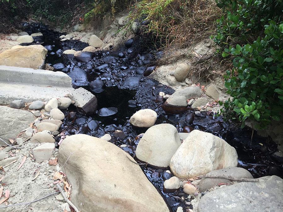 Crude oil flows down a river gorge after a spill in Ventura, Calif., on Thursday. (Rob Varela/The Ventura County Star via AP)