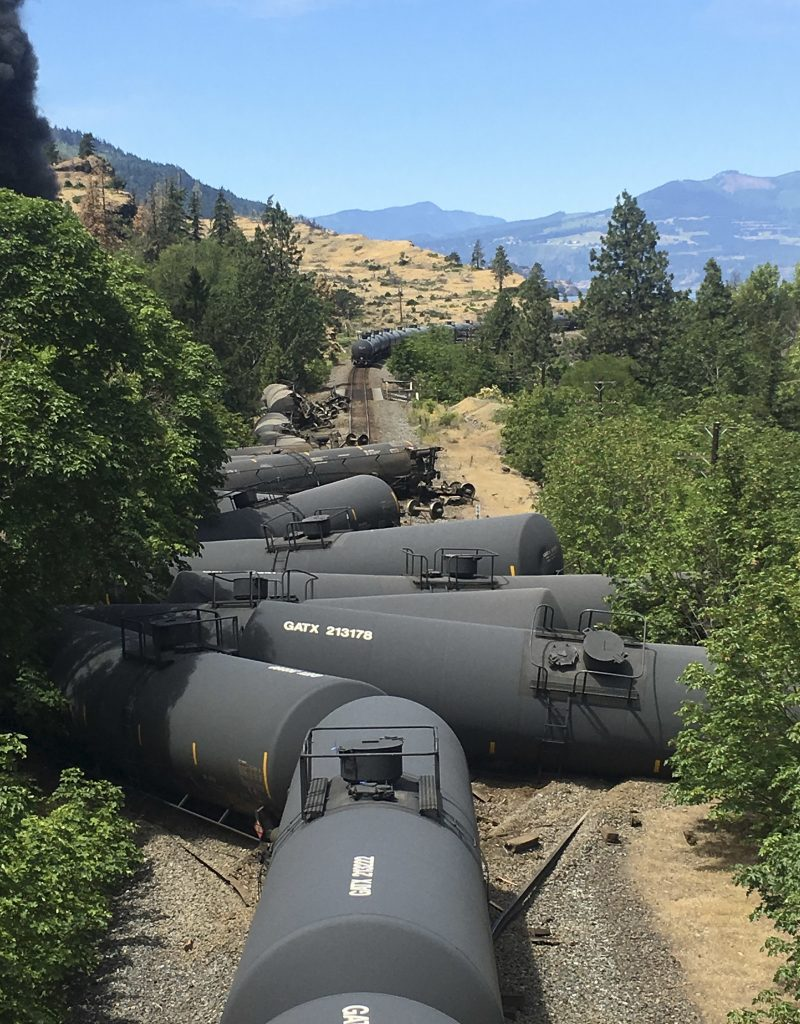 Tank cars carrying oil are derailed near Mosier, Ore., on June 3. (Silas Bleakley via AP, file)