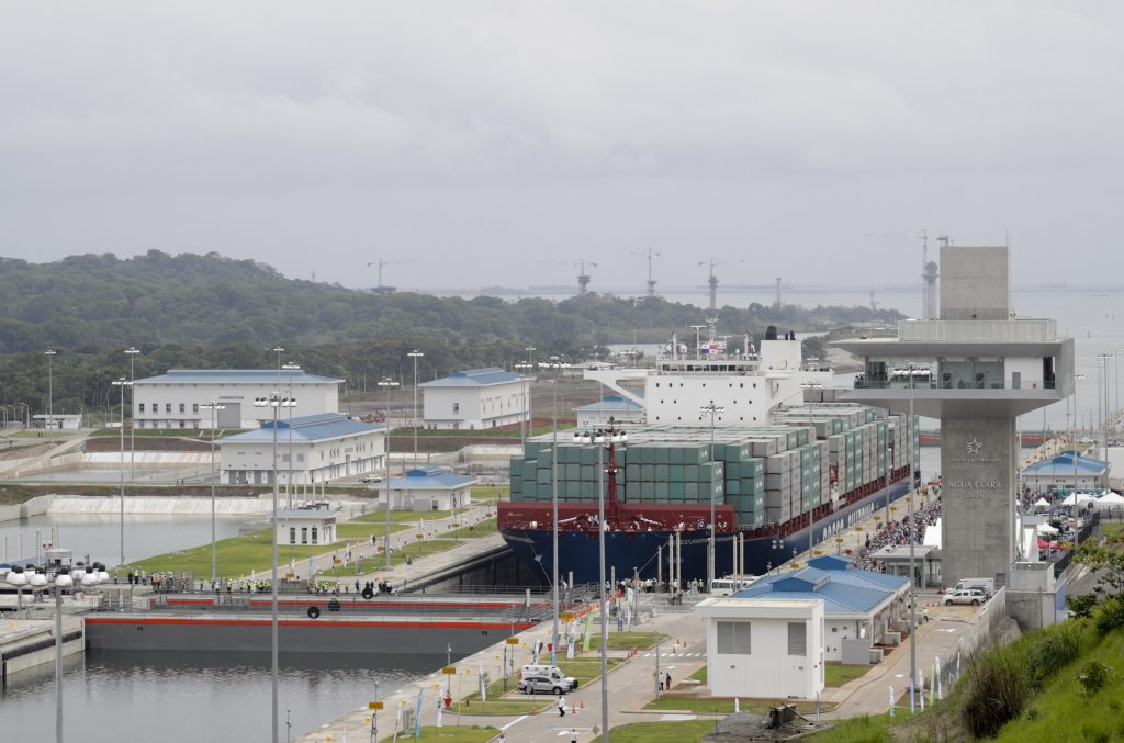 The Neopanamax cargo ship, Cosco Shipping Panama, makes its way through the new Agua Clara locks, part of the Panama Canal expansion project, near the port city of Colon, Panama, on Sunday. (AP Photo/ Arnulfo Franco)