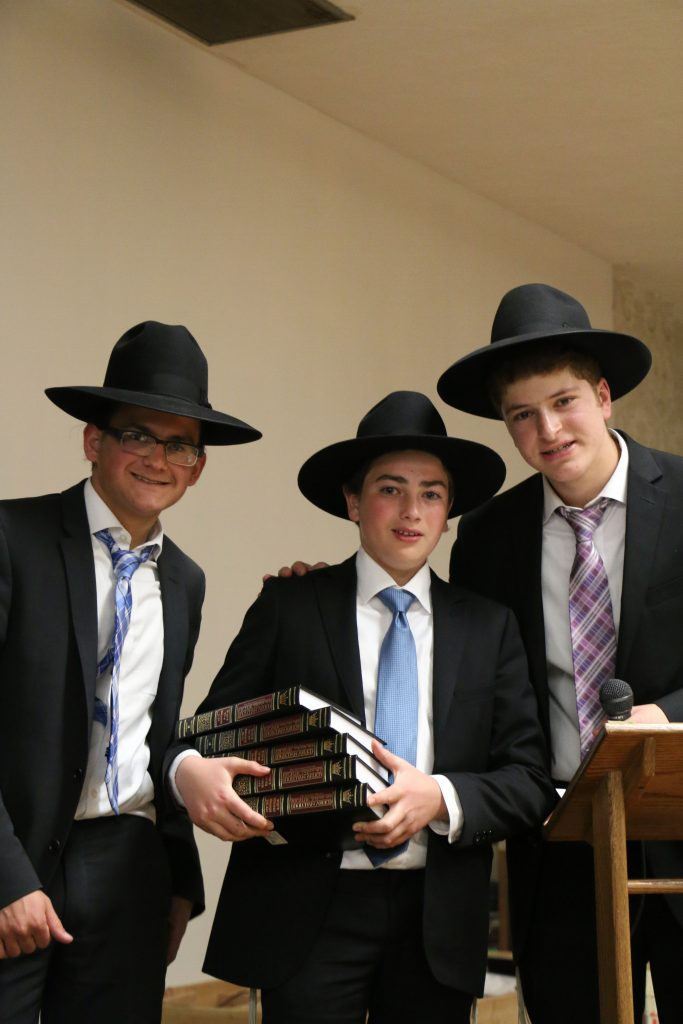 A prize winner with Shmuel Kagan and Mordechai Joseph. (Sruly Abrams/Agudath Israel of America)