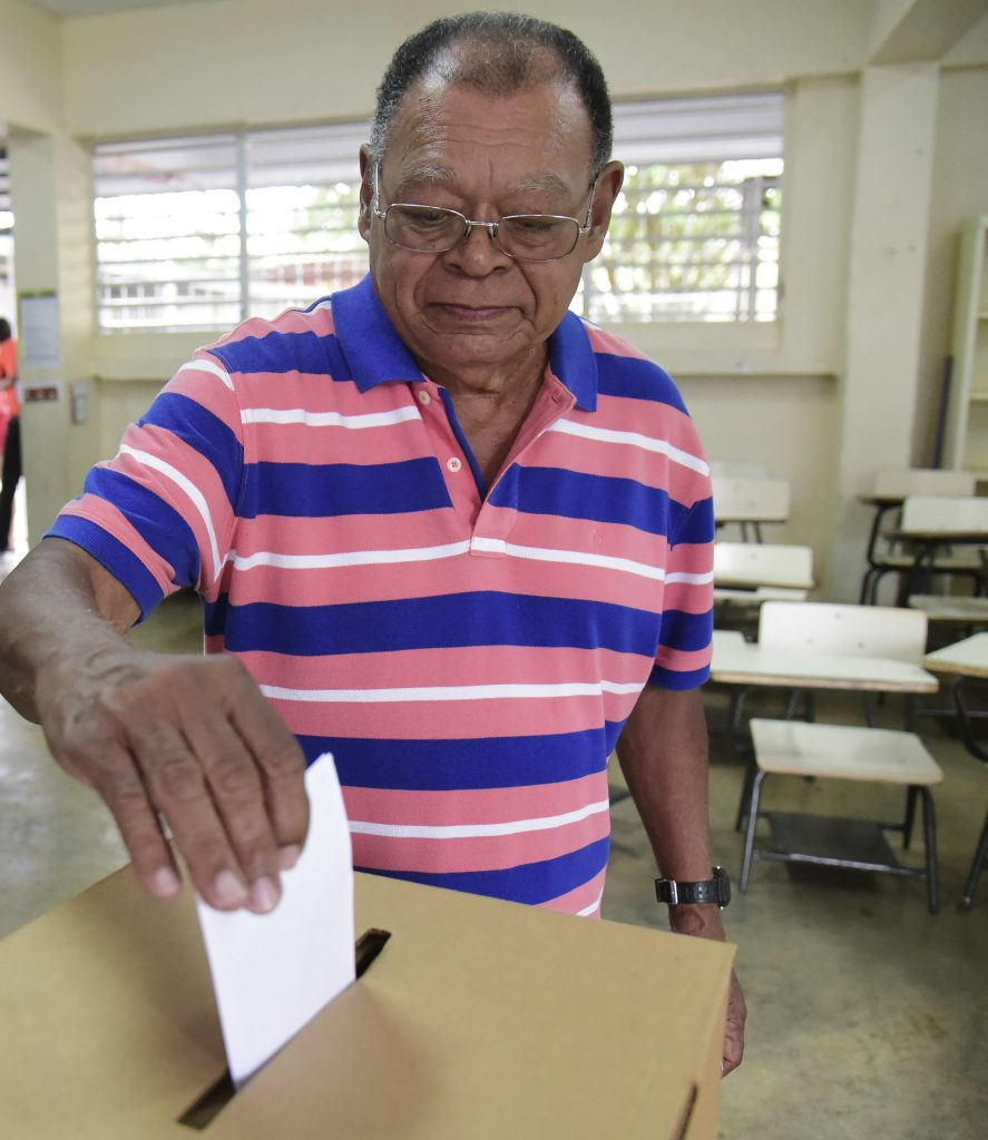 Puerto Rico resident Hector Alvarez casts his ballot during the U.S. territory's Democratic primary election at the Luis Llorens Torres Elementary School in San Juan, Puerto Rico, on Sunday. (AP Photo/Carlos Giusti)