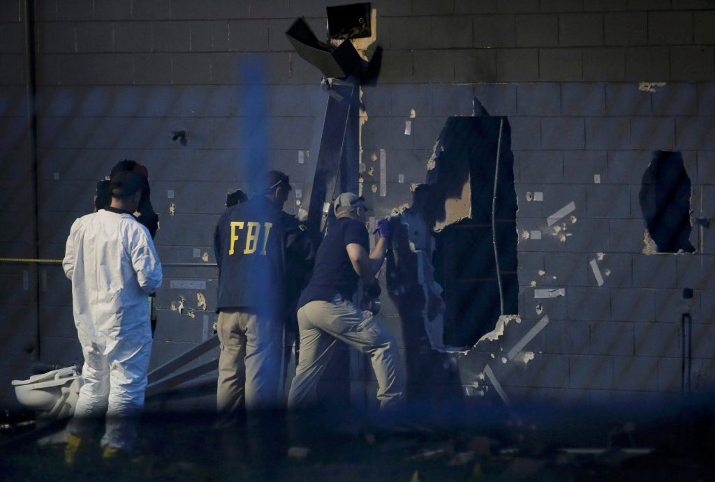 Police forensic investigators work at the scene of the mass shooting in Orlando, Florida, on Sunday. (Reuters/Jim Young)