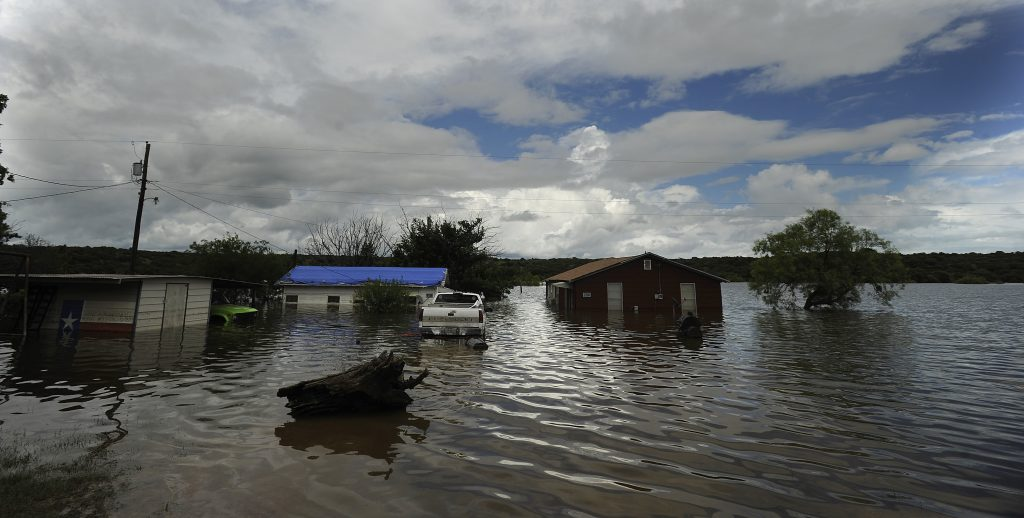 Houses sit in flooded lake waters at Lake Cisco, Friday, June 3, 2016, west of Cisco, Texas. (Tommy Metthe/Abilene Reporter-News via AP)