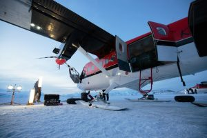 One of the two Canadian-owned Twin Otter turboprop planes used to help reuscue two workers from a remote U.S. science station at the South Pole, being serviced at Rothera Research Station in Antarctica on Wednesday. (British Antarctic Survey via AP)
