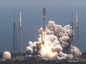 In this Aug. 5, 2011 file photo, an Atlas V rocket carrying the Juno spacecraft lifts off from Space Launch Complex-41 in Cape Canaveral, Fla. It was the first step in Juno's 1.7 billion-mile voyage to the gas giant planet, Jupiter. (AP Photo/Terry Renna)