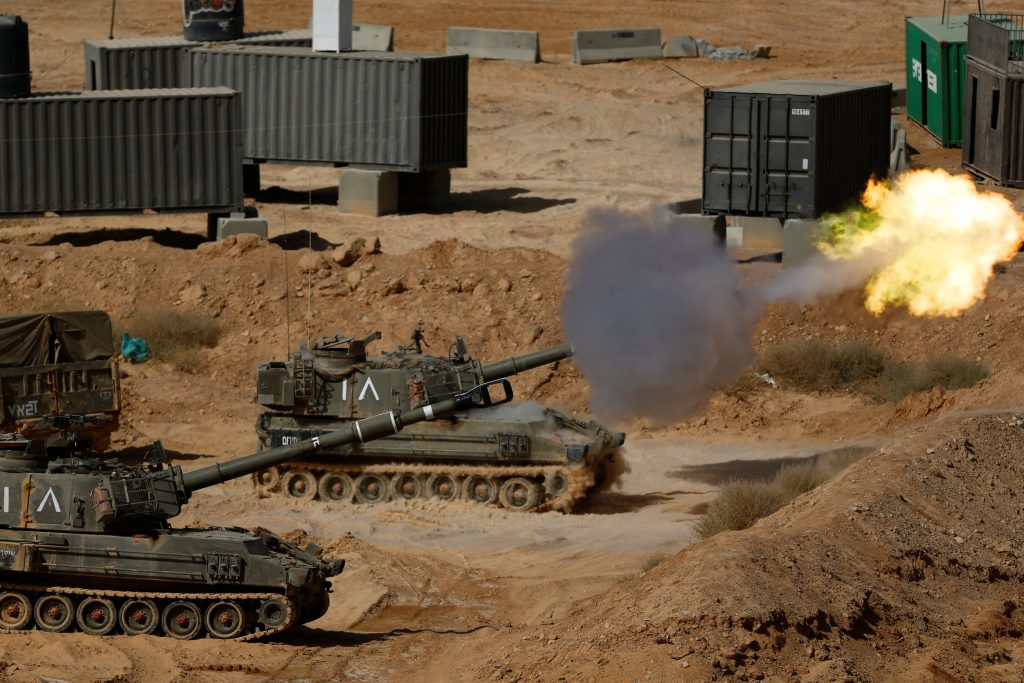 An Israeli mobile artillery unit fires during the militray drill on Tuesday. (Reuters/Amir Cohen)