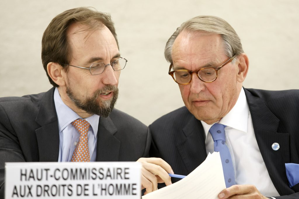 UN High Commissioner for Human Rights Zeid Ra'ad Al Hussein, left, of Jordan, and Deputy UN Secretary-General Jan Eliasson, right, read documents, during the 32nd session of the Human Rights Council, at the European headquarters of the United Nations in Geneva, Switzerland, Monday, June 13, 2016. (Salvatore Di Nolfi/Keystone via AP)