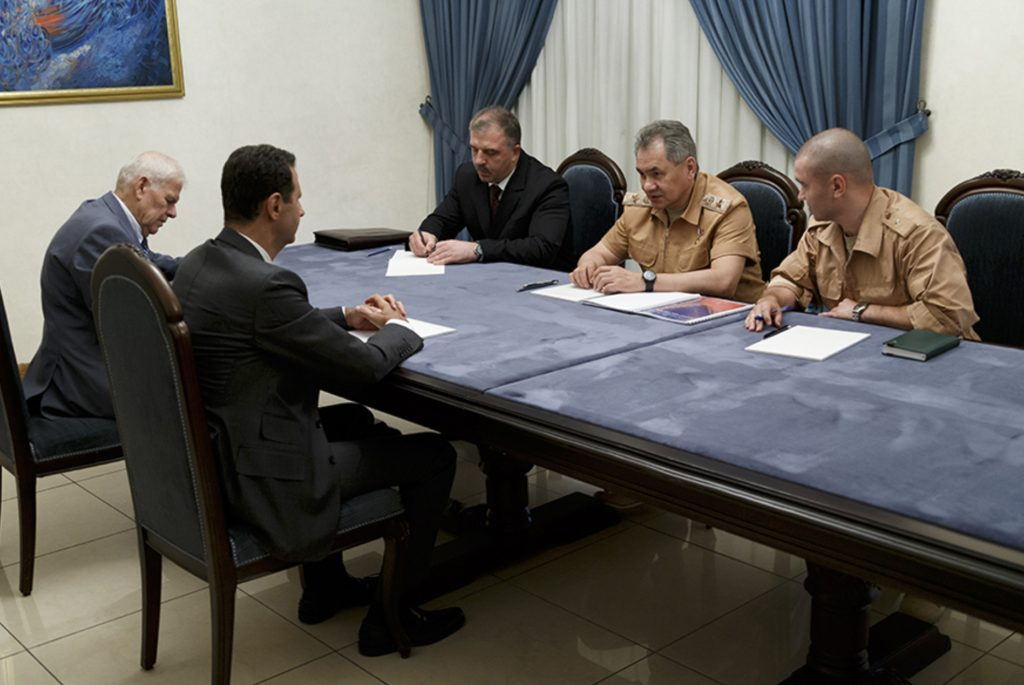 RETRANSMITTING FOR IMPROVED QUALITY Syrian President Bashar Assadleft, meets with Russian Defense Minister Sergei Shoigu, second right back, in Damascus, Syria, Saturday, June 18, 2016. Russia's defense minister visited Syria on Saturday to meet the country's leader and inspect the Russian air base there, a high-profile trip intended to underline Moscow's role in the region. (Vadim Savitsky/ Russian Defense Ministry Press Service pool photo via AP)