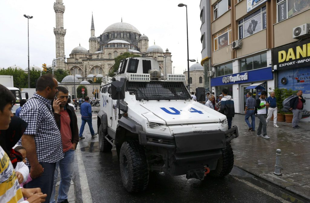 An armoured vehicle drives near a Turkish police bus which was targeted in a bomb attack in a central Istanbul district, Turkey, June 7, 2016. REUTERS/Osman Orsal
