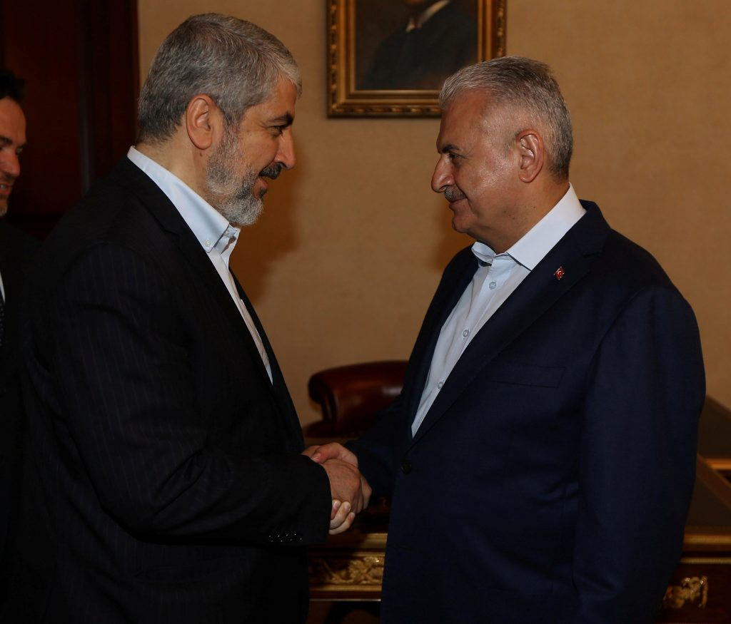 Turkish Prime Minister Binali Yildirim (R) meets with Khaled Meshaal, leader of the Palestinian militant group Hamas, in Istanbul, Turkey, June 25, 2016. Hakan Goktepe/Turkish Prime Minister's Press Office/Handout via REUTERS ATTENTION EDITORS - THIS PICTURE WAS PROVIDED BY A THIRD PARTY. FOR EDITORIAL USE ONLY. NO RESALES. NO ARCHIVE.