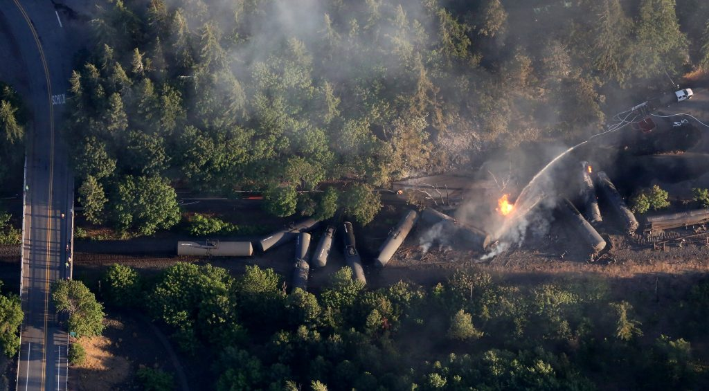An oil train burns near the Oregon town of Mosier after derailing Friday, June 3, 2016. (Alan Berner(/The Seattle Times via AP) MANDATORY CREDIT TO BOTH THE SEATTLE TIMES AND THE PHOTOGRAPHER