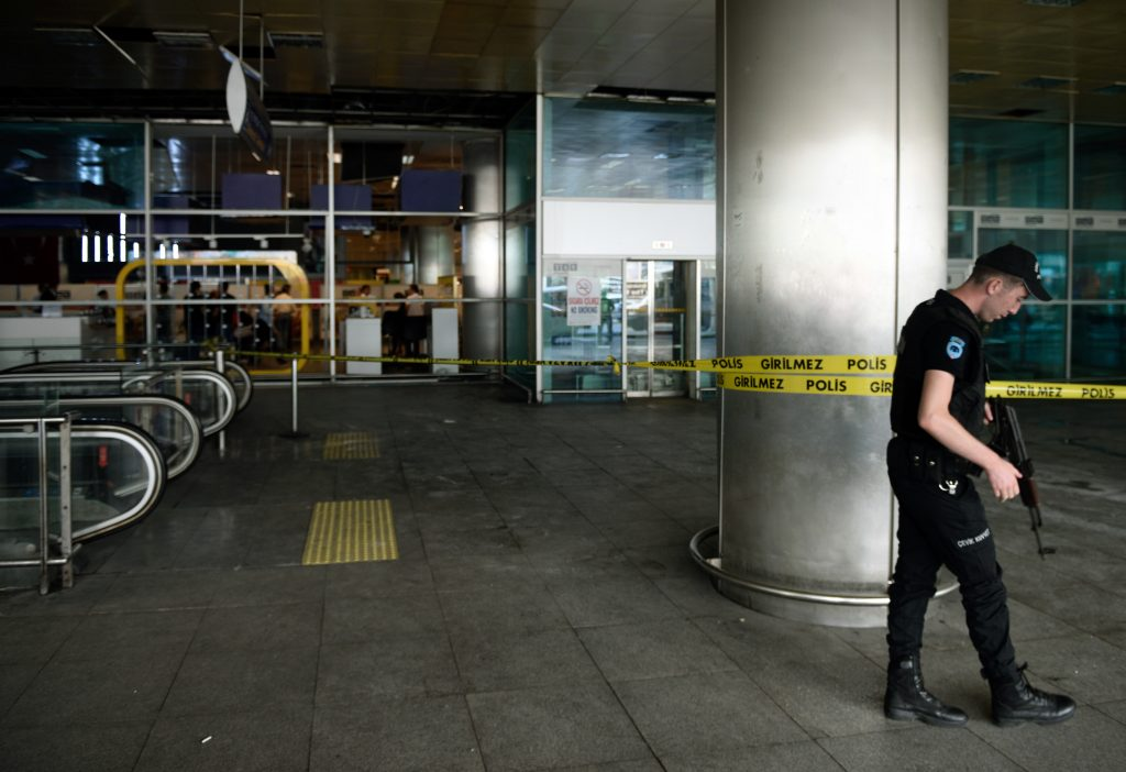 A police officer patrols outside Ataturk Airport in Istanbul, Wednesday, June 29, 2016. Suicide attackers killed dozens and wounded more than 140 at Istanbul's busy Ataturk Airport late Tuesday, the latest in a series of bombings to strike Turkey in recent months. Turkish officials said the massacre was most likely the work of the Islamic State group. (AP Photo) TURKEY OUT