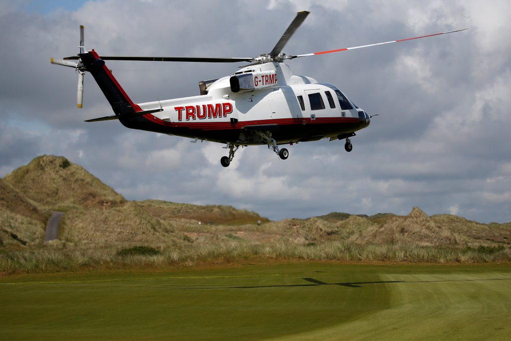 The helicopter of Republican presidential candidate Donald Trump lands on the golf course at his Trump International Golf Links in Aberdeen, Scotland, June 25, 2016. REUTERS/Carlo Allegri