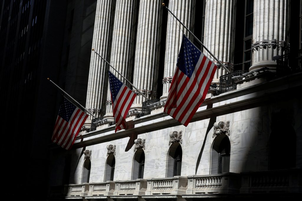 Flags fly at half staff to honor the victims of the shooting at the Pulse night club in Orlando, Florida, at the New York Stock Exchange (NYSE) in New York City, NY, U.S. June 13, 2016. REUTERS/Brendan McDermid