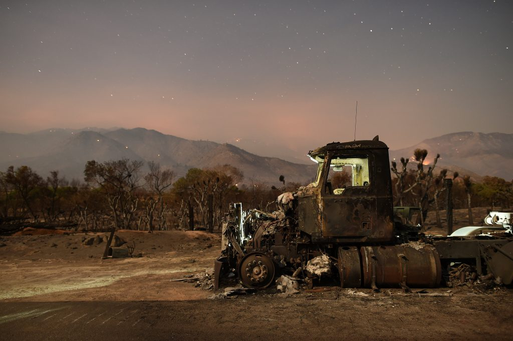 A burned out truck rests on a roadside after the Erskine Fire burned through Weldon, California, U.S. June 26, 2016. REUTERS/Noah Berger TPX IMAGES OF THE DAY