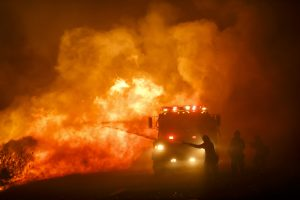 Firefighters combat the front lines of the Sherpa Fire to avoid it from moving onto the 101 freeway, along Calle Real Road, in Goleta, Calif., on Thursday. (Marcus Yam/Los Angeles Times/TNS)