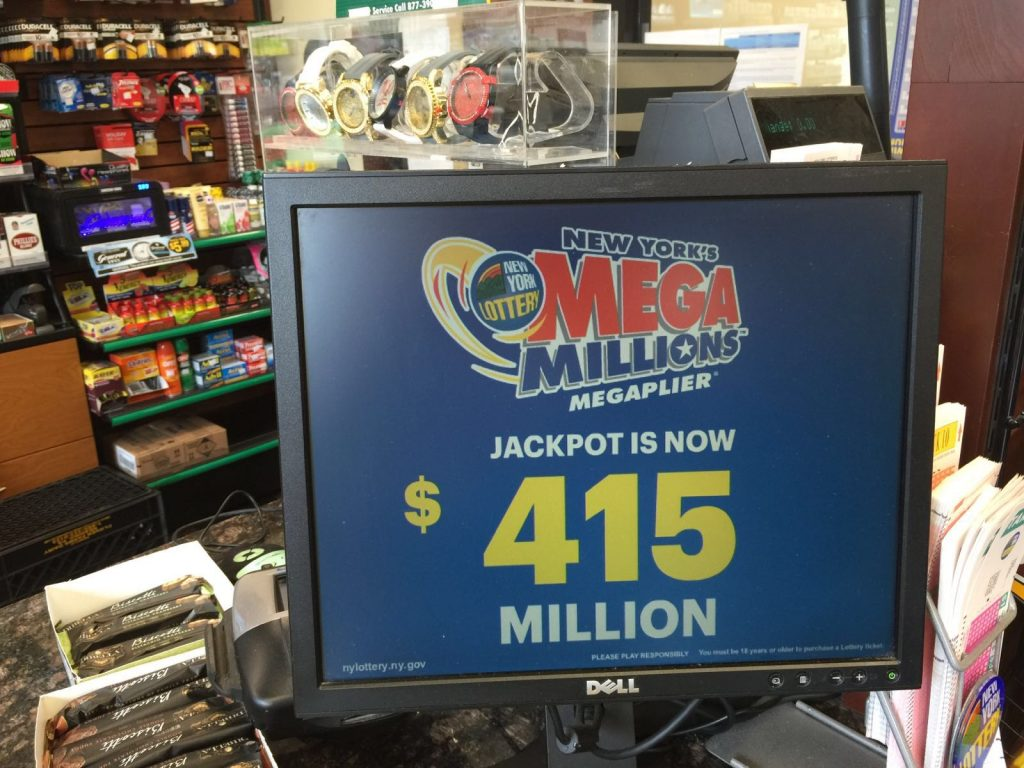 A sign displays the Mega Millions jackpot on Wednesday morning in Brooklyn. (Isser Berg/Hamodia)