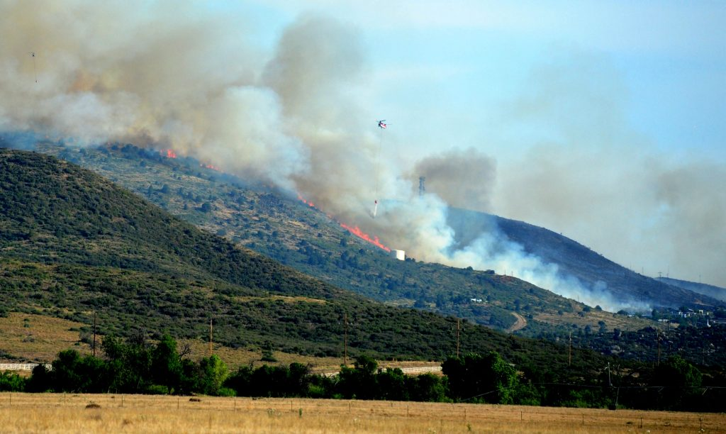 A brush fire burns in Yarnell, Ariz., Wednesday, June 8, 2016. The brush fire threatened structures Wednesday in the north-central Arizona town of Yarnell — the scene of a 2013 wildfire in which 19 members of an elite firefighting crew were killed. Some residents on the town's east and west sides were being told to evacuate their homes as a precaution, Yavapai County sheriff's officials said. (Les Stukenberg/The Daily Courier via AP) MANDATORY CREDIT