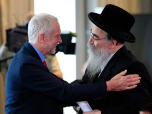 Jeremy Corbyn greets Rabbi Avrohom Pinter at the launch, Thursday.
