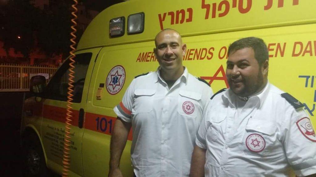 Ohr Kadosh (R) with Dotan Katz in front of an MDA ambulance. (MDA)