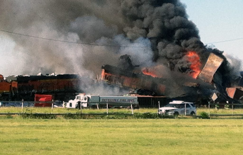 In this photo provided by Billy B. Brown, two freight trains are on fire Tuesday, June 28, 2016. (Billy B. Brown via AP)