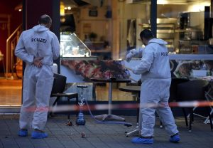 Police forensic experts work at the scene of the attack. (Reuters/Vincent Kessler)