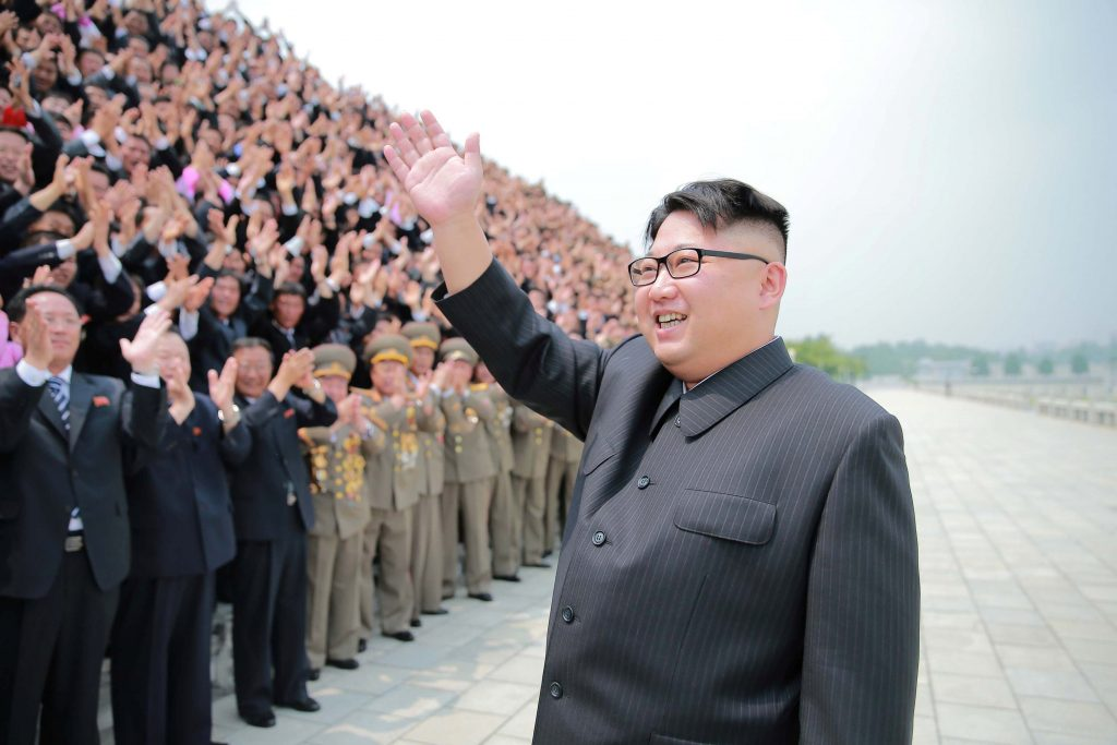 North Korean leader Kim Jong Un waves at a photo session with officials, in an undated photo released by North Korea's Korean Central News Agency last month. (Reuters/KCNA)