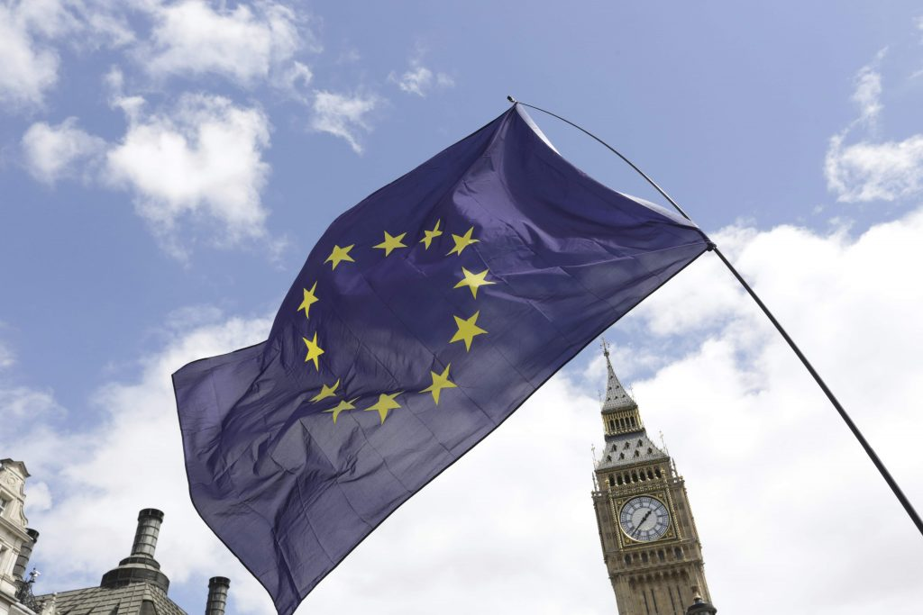 A European Union flag is held in front of the Big Ben clock tower in Parliament Square during a 'March for Europe' demonstration against Britain's decision to leave the European Union, central London. (Paul Hackett/Reuters)