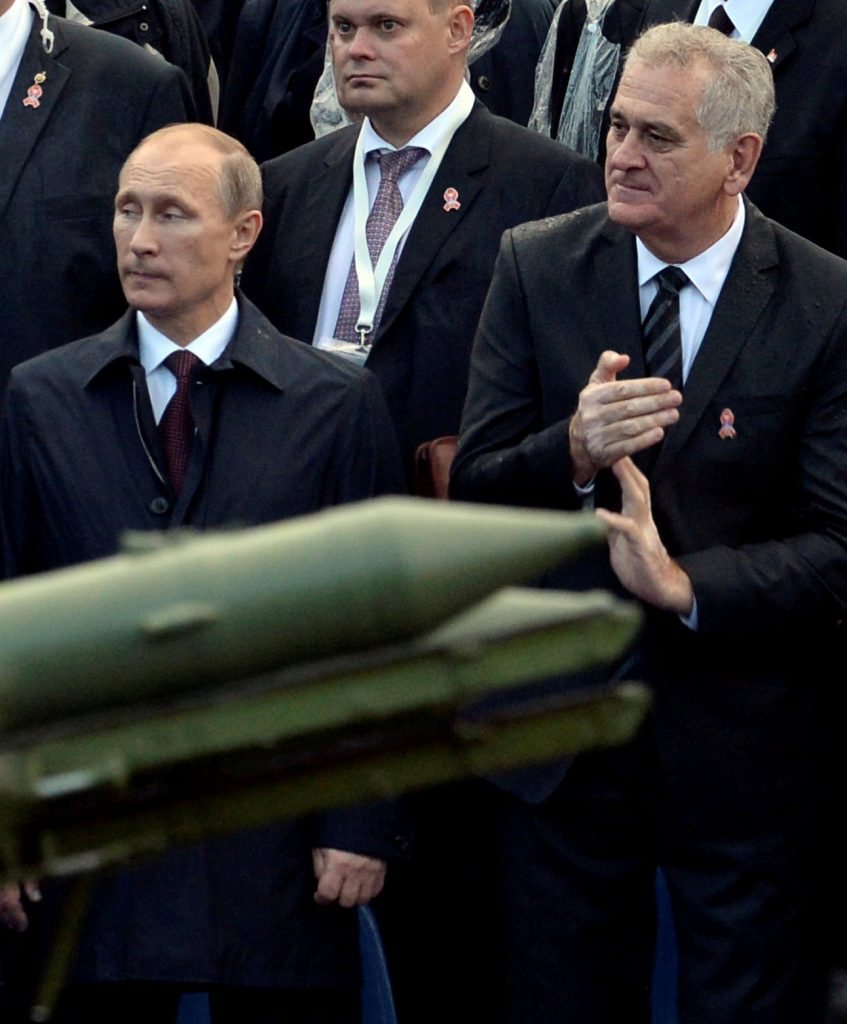In this October 16, 2014, photo, Russian President Vladimir Putin (L) and Serbian President Tomislav Nikolic attend a military parade to mark 70 years since the city's liberation by the Red Army in Belgrade, Serbia. (Reuters/Vasily Maximov/Pool/File)