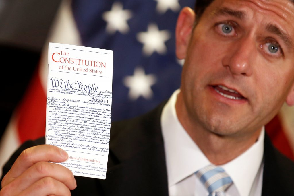 U.S. House Speaker Paul Ryan (R-WI) holds a copy of the United States constitution during a press conference at the Republican National Committee in Capitol Hill, Washington, U.S., July 6, 2016. REUTERS/Carlos Barria
