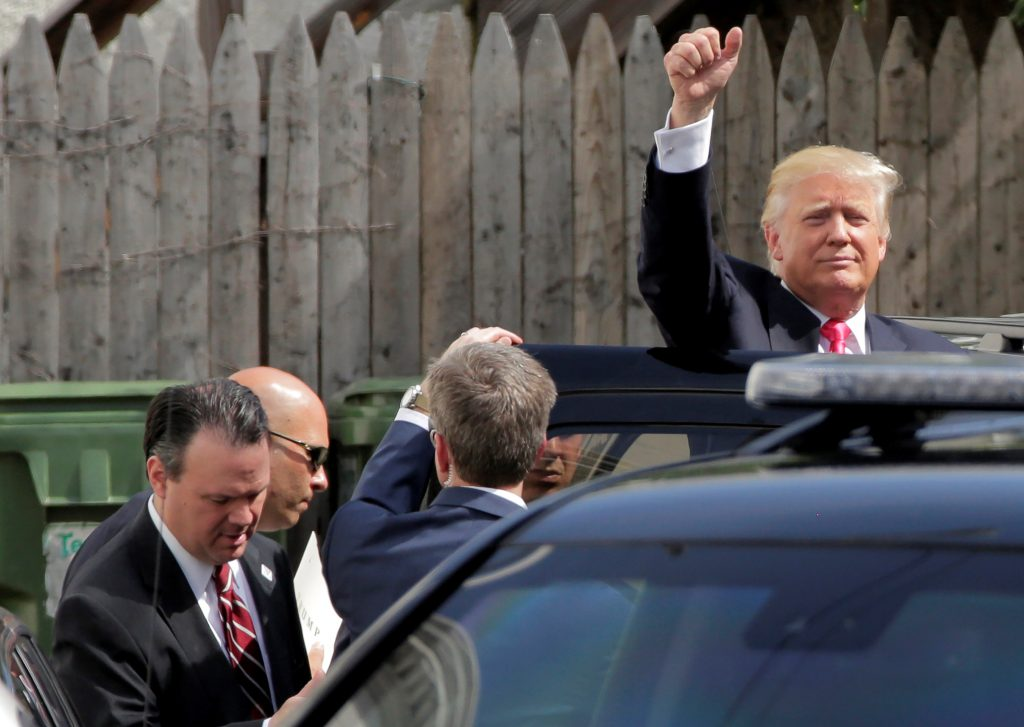 Donald Trump leaves after meeting with Republican House members in Washington, on Thursday. (Reuters/Joshua Roberts)