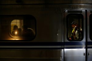Policemen check a train after an explosion at the Songshan station in Taipei, Taiwan, on Thursday. (Reuters/Tyrone Siu)