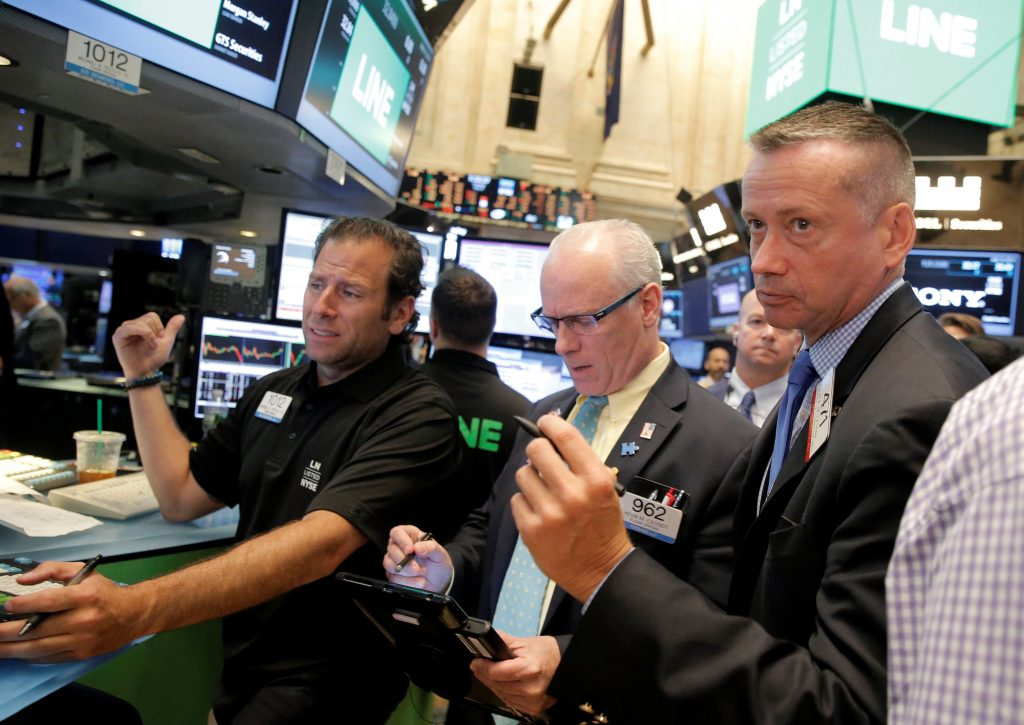 Traders work on the floor of the New York Stock Exchange on Thursday. (Reuters/Brendan McDermid)