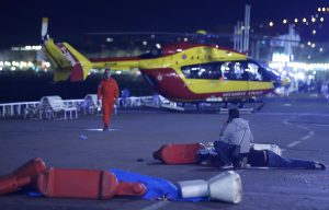 An injured individual is seen on the ground, and a medical helicopter in the background, after the attack Thursday in Nice, France. (Reuters/Eric Gaillard)