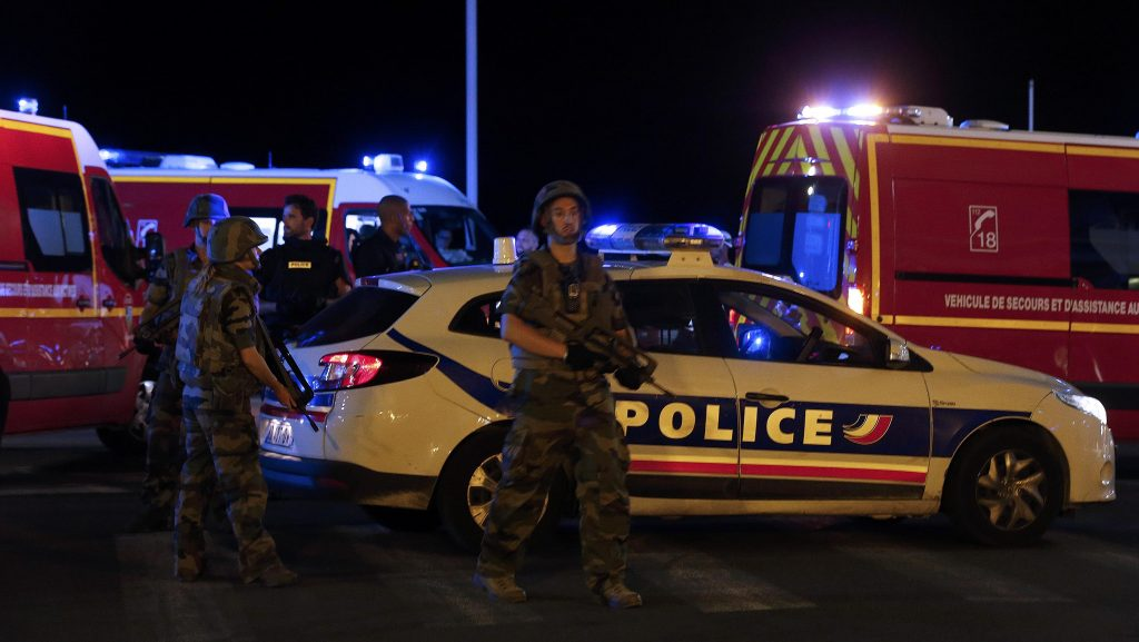 French soldiers and rescue forces are seen at the scene of teh attack in Nice. (Reuters/Eric Gaillard)