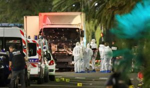 French police forces and forensic officers next to the bullet-riddled truck that plowed into a crowd celebrating the Bastille Day in Nice, France. (Reuters/Eric Gaillard)