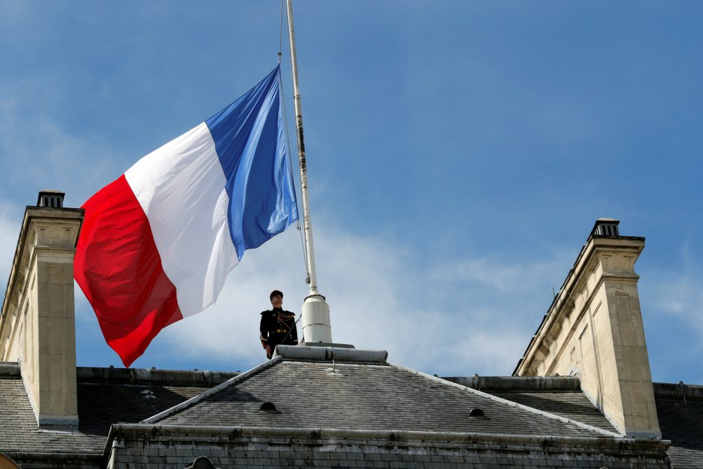 The French flag at half-mast at the Elysee Palace in Paris on Friday (Reuters/Philippe Wojazer)