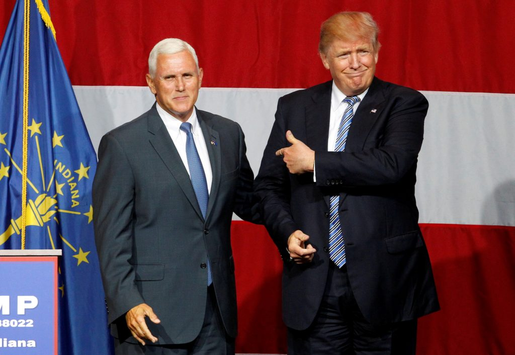 Republican presidential candidate Donald Trump (R) and Indiana Governor Mike Pence (L) wave to the crowd before addressing the crowd during a campaign stop at the Grand Park Events Center in Westfield, Indiana, July 12, 2016. (John Sommers II/Reuters/File)