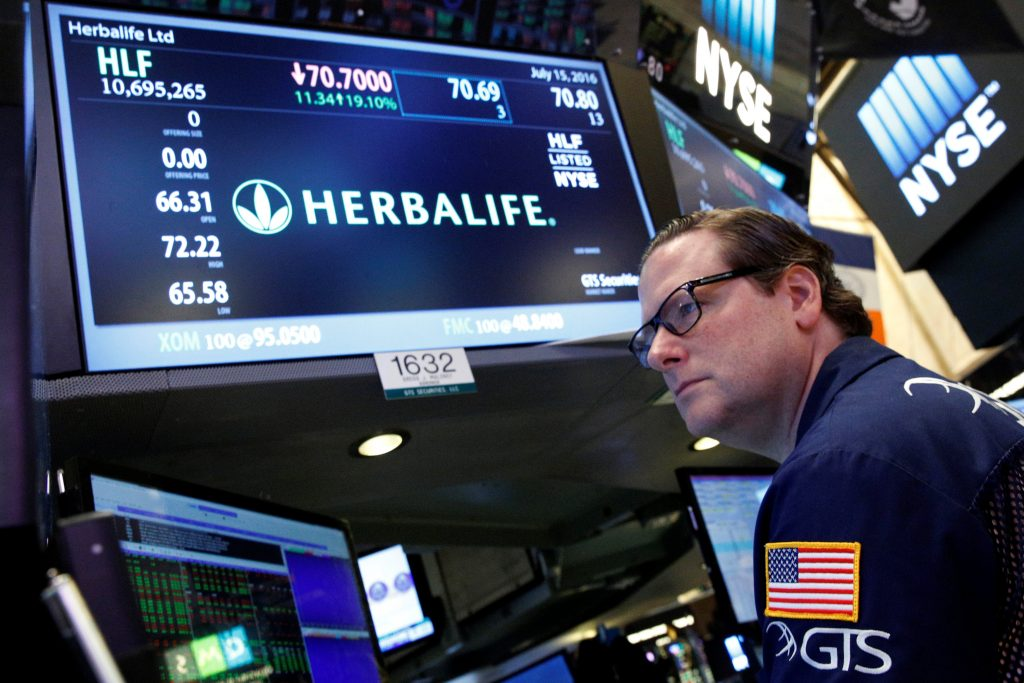 Specialist trader Gregg Maloney works at the post where Herbalife is traded on the floor of the New York Stock Exchange on Friday. (Reuters/Brendan McDermid)