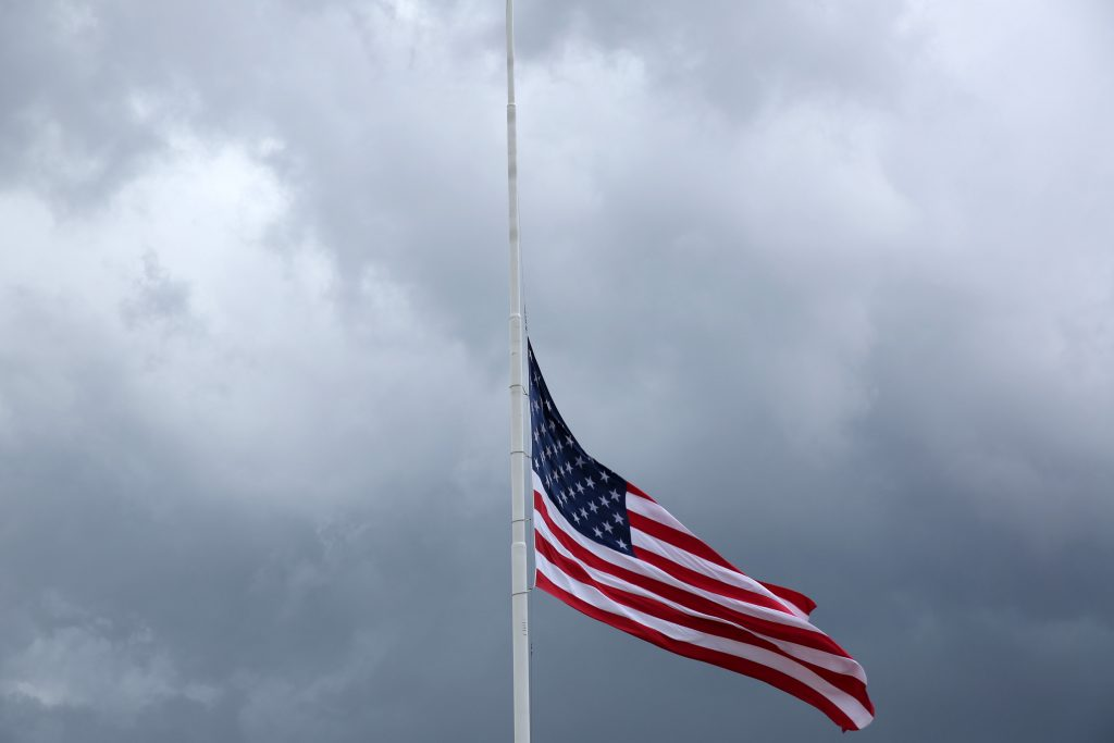 An American flag flies at half-mast near the scene of a fatal shooting of police officers in Baton Rouge, Louisiana, on Sunday. (Reuters/Joe Penney)