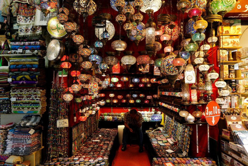 A shopkeeper waits for customers at the Grand Bazaar, known as the Covered Bazaar, in Istanbul, Turkey, July 19, 2016. (Ammar Awad/Reuters)